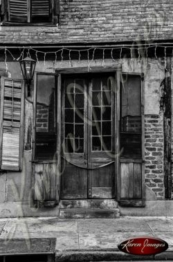 black and white front doors of the oldest pub on bourbon street new orleans louisiana