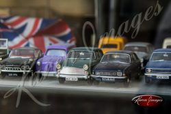 antique toy cars in a store window in france