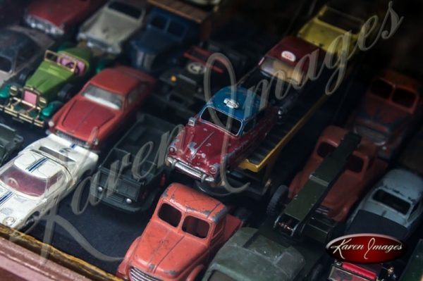 Antique Toy Cars in a Window in France