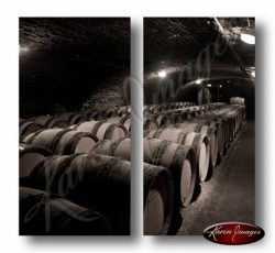 sepia image of burgundy pinot noir barrels in the caves of ropiteau meursault france