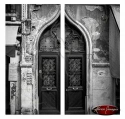 black and white image of ancient door in venice italy