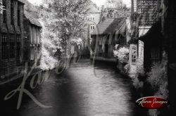Black and white of brugge belgium canal with brick homes