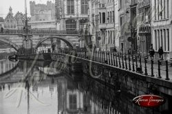 Black and white of brugge belgium view of ancient canal and brick facades ancient medieval city view