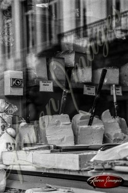 Black and white of cheese in a store window