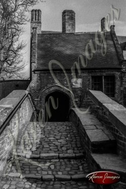 Black and white of brugge belgium ancient old brick bridge over canal